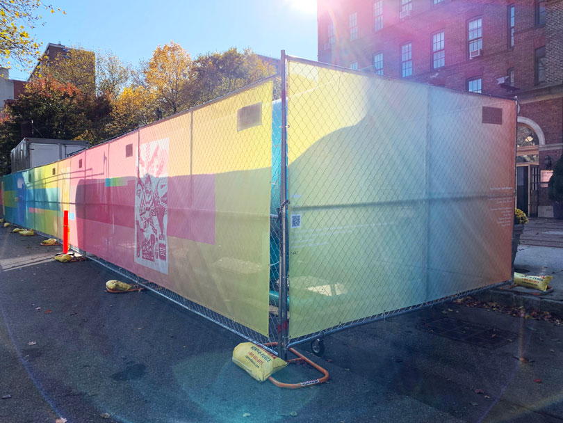 A view of one of the corners of the GenZ installation on the Pratt Brooklyn campus. The installation is a fencing cover and is bright with neon gradients.