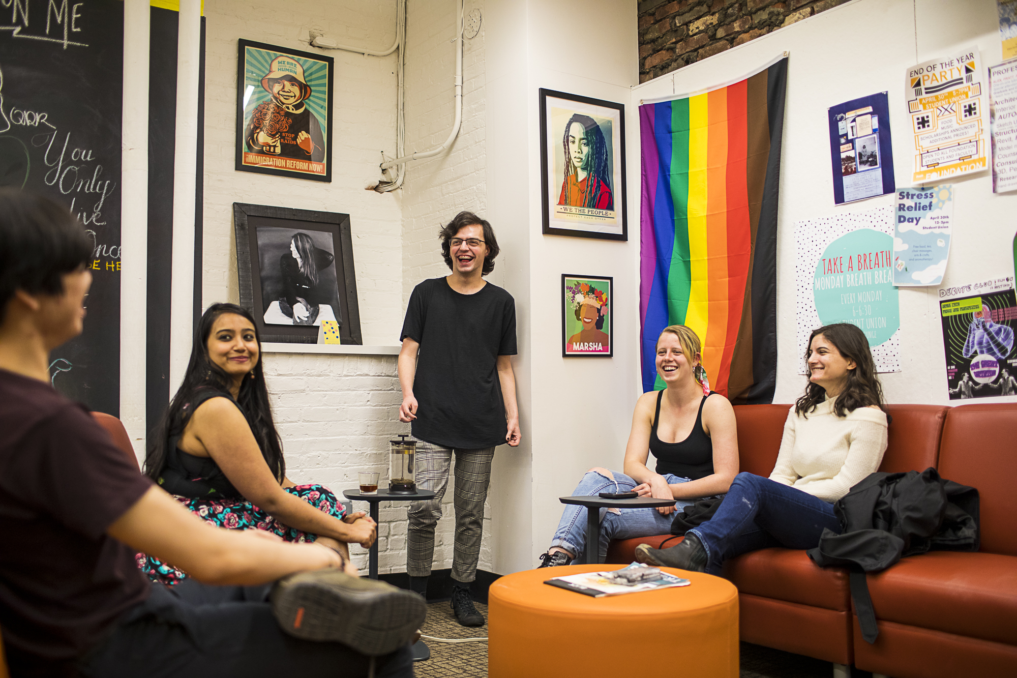 Photograph of five students sitting in a circle, hosting a meeting in the Center for Equity and Inclusion