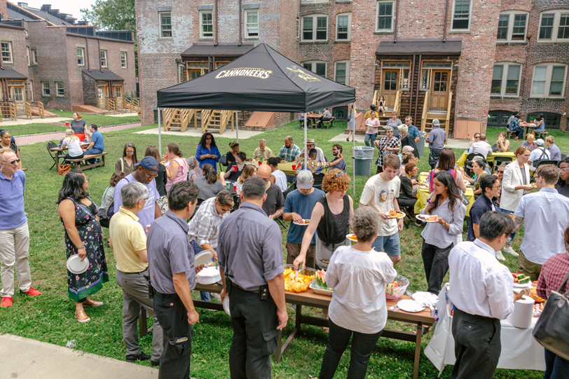 Event photograph from the 2019 Pratt Staff and Faculty Picnic with staff and faculty members lining up on the lawn to get food