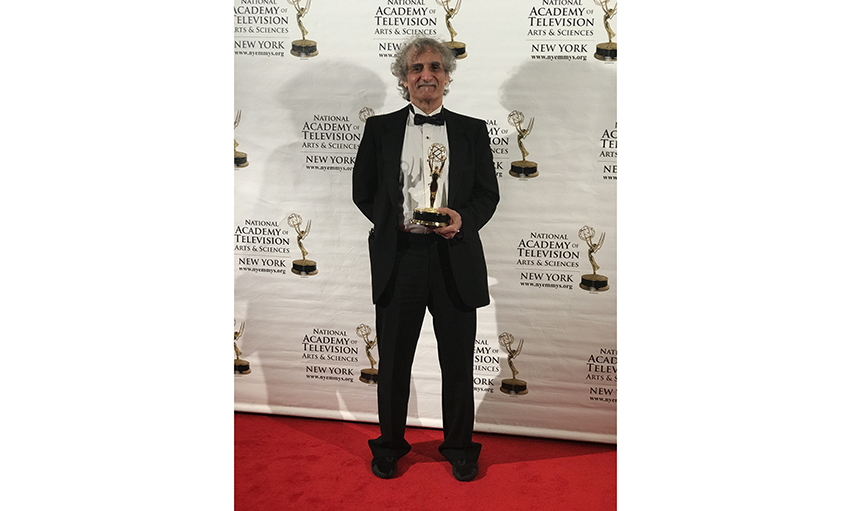Steven Doloff, professor and acting chair of Dept of Humanities and Media Studies within Pratt Institute's School of Liberal Arts and Sciences, with his 2017 Emmy for Theater Talk