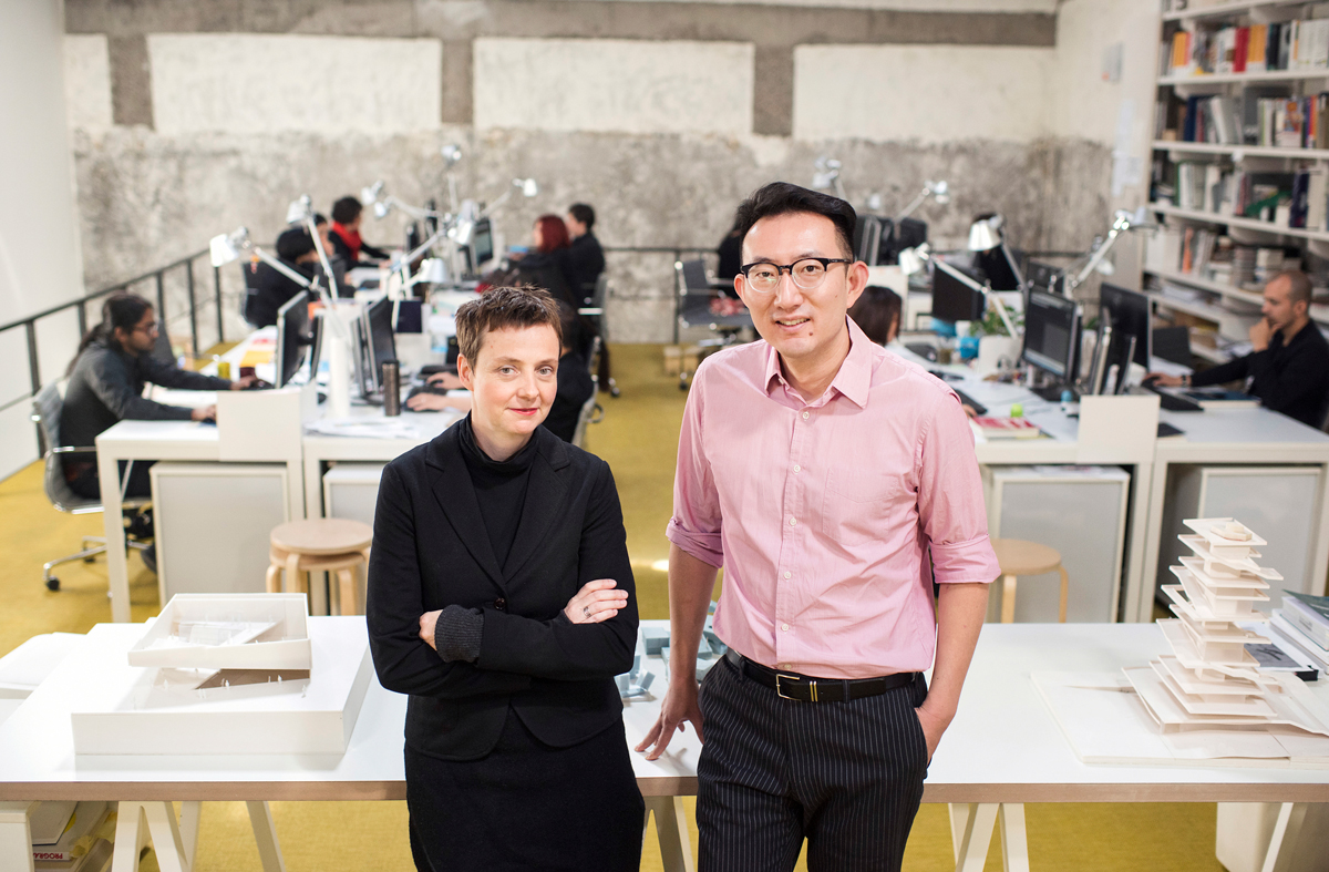 Binke Lenhardt and Hao Dong standing together in their studio.