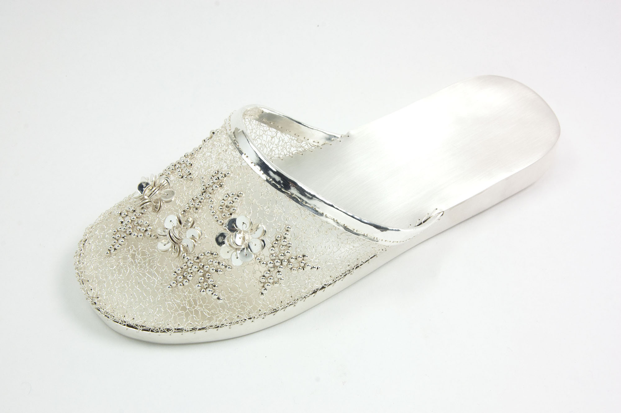 """Ada Chen, """"Chinese Slipper"""" (2017), fine silver with sterling silver beads, featured in Collective Ground at Steuben Gallery"""
