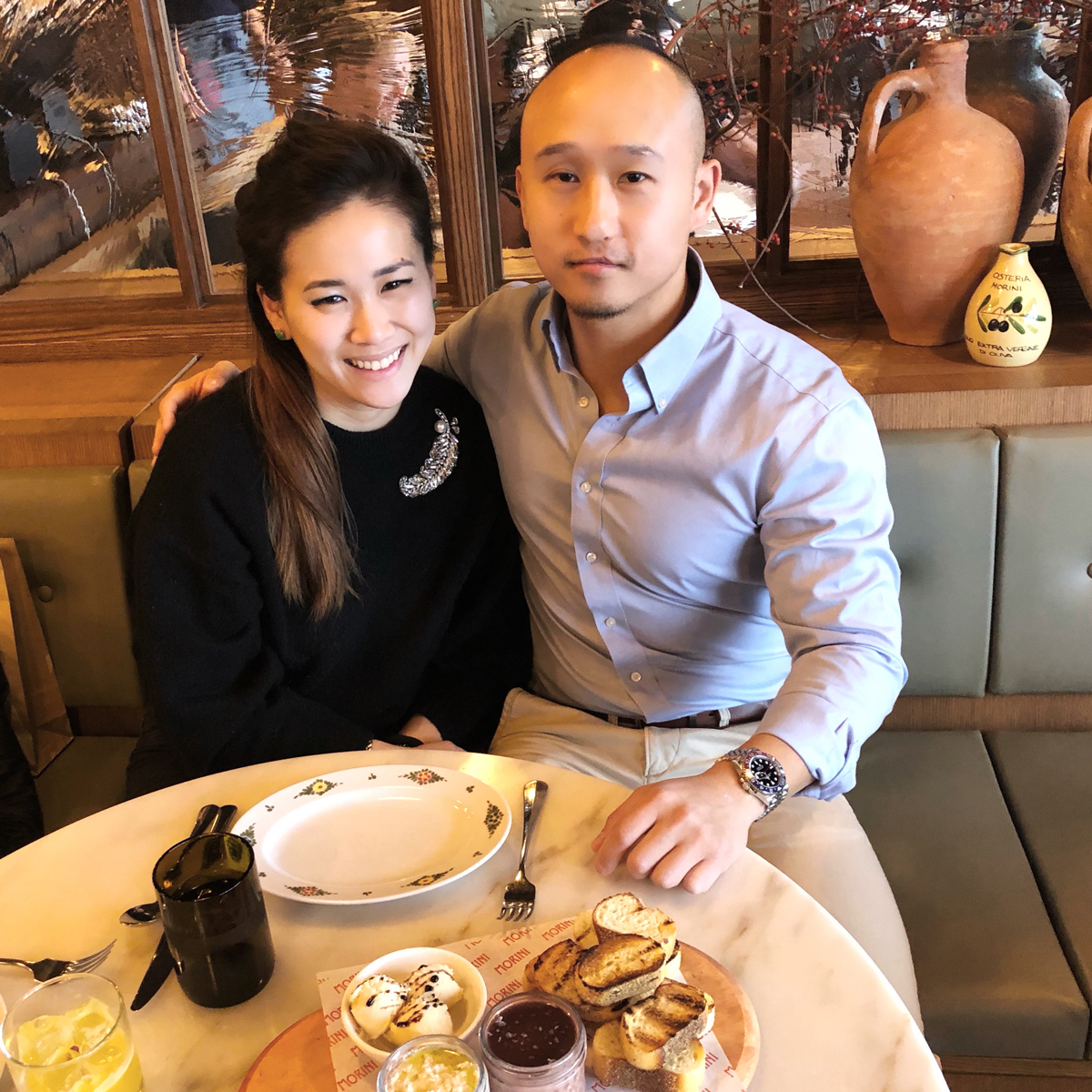 Janet Lee Chiang and Kenneth Chiang sitting together in a restaurant.