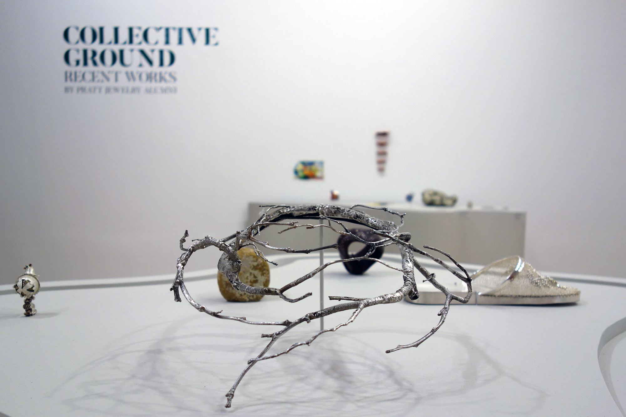 Installation view of Collective Ground at Steuben Gallery, with work by Carrie Bilbo at center