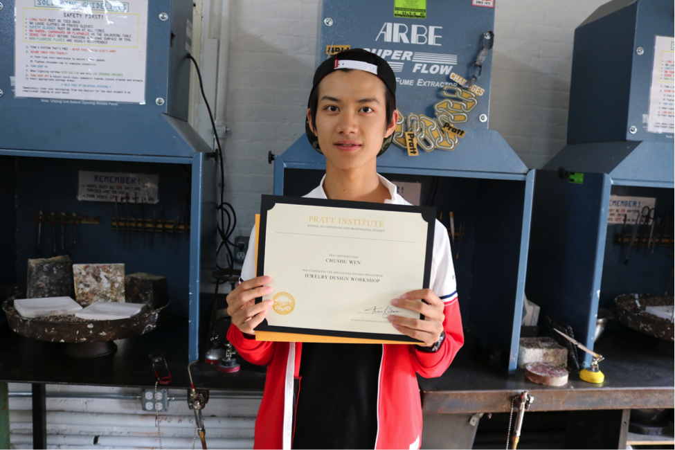 Student holding a certificate