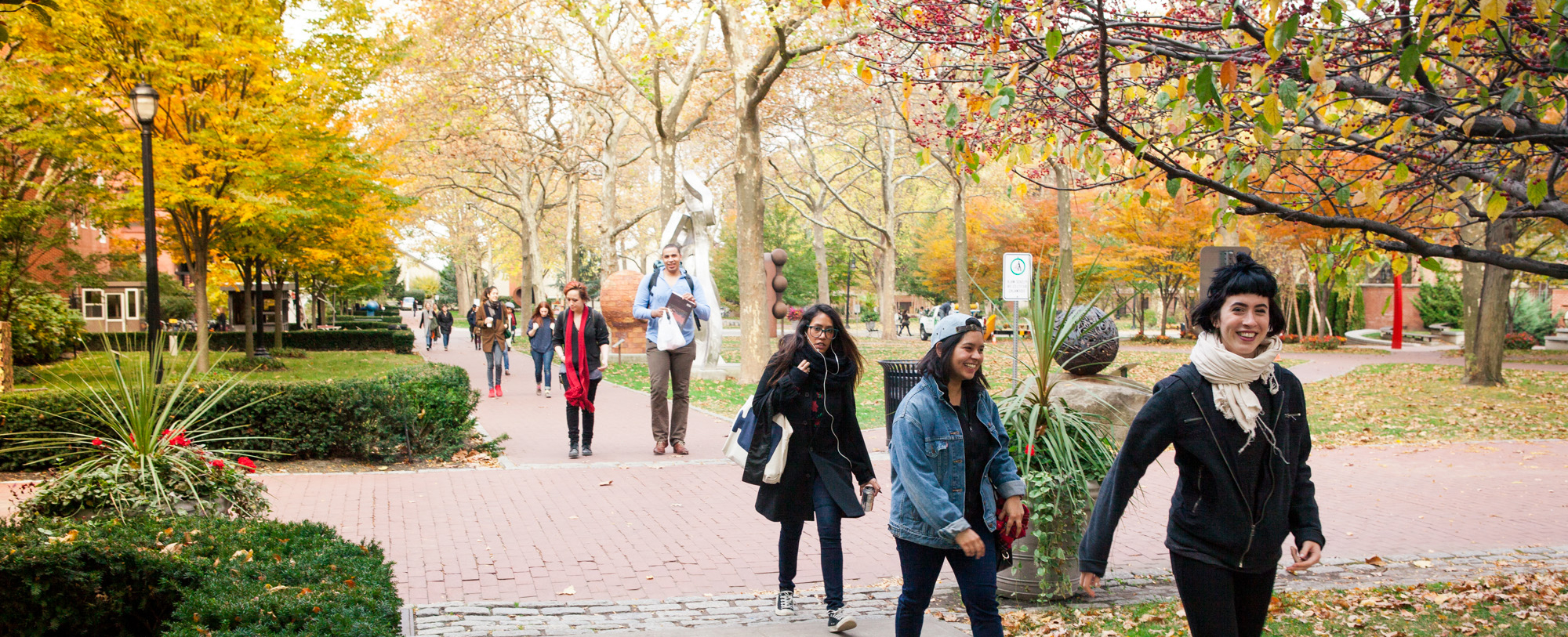 Pratt students walk through campus on a fall day