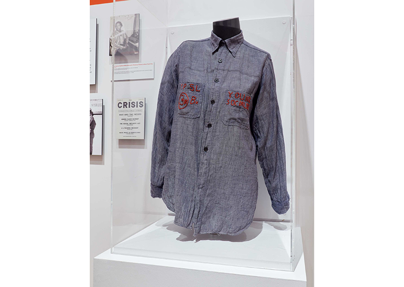 Installation view of Estelle M. Horowitz's Young People's Socialist League shirt in City of Workers, City of Struggle: How Labor Movements Changed New York