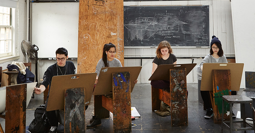 Students drawing in a classroom