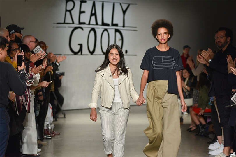 Graduating senior Elle Romero walks the runway with a model wearing one of her looks at Pratt Shows: Fashion | Really Good