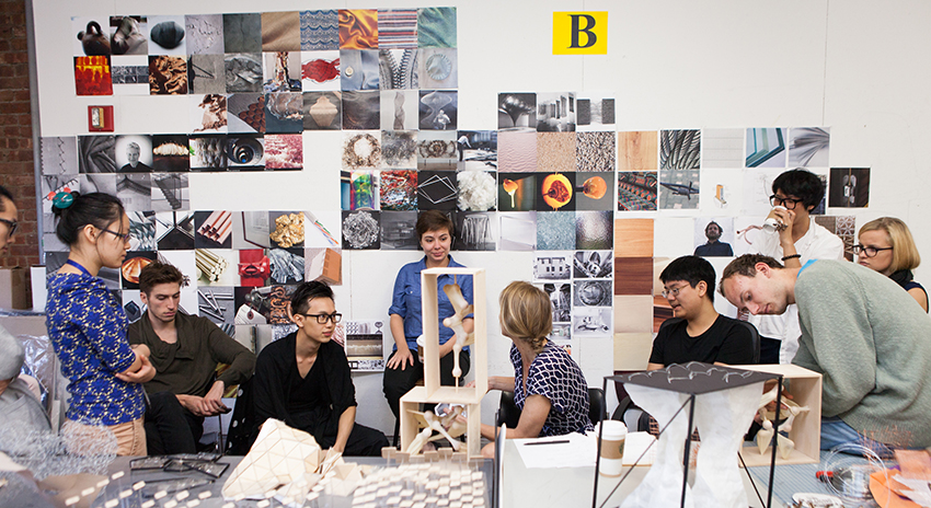 Pratt students talking in a workspace