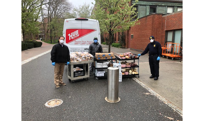 Pratt Public Safety Tour Supervisor Tyrone Spence, Rethink Food NYC Driver Elijah Inniss, and Dennis Mazone, Assistant Vice President of Campus Safety and Preparedness, facilitating the donation of food from Pratt