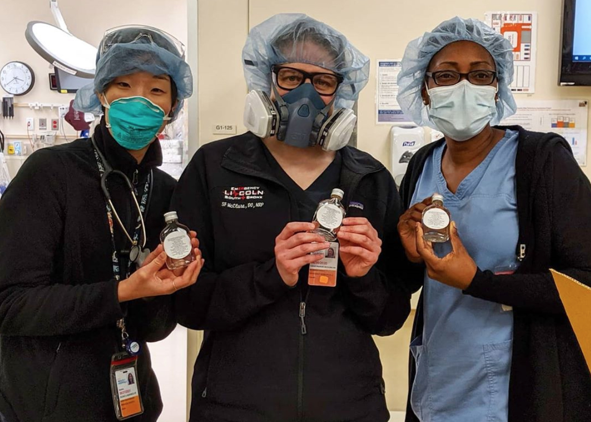 Frontline workers at Lincoln Hospital in the Bronx with hand sanitizer donated by Made in NYC member MÔTÔ Spirits