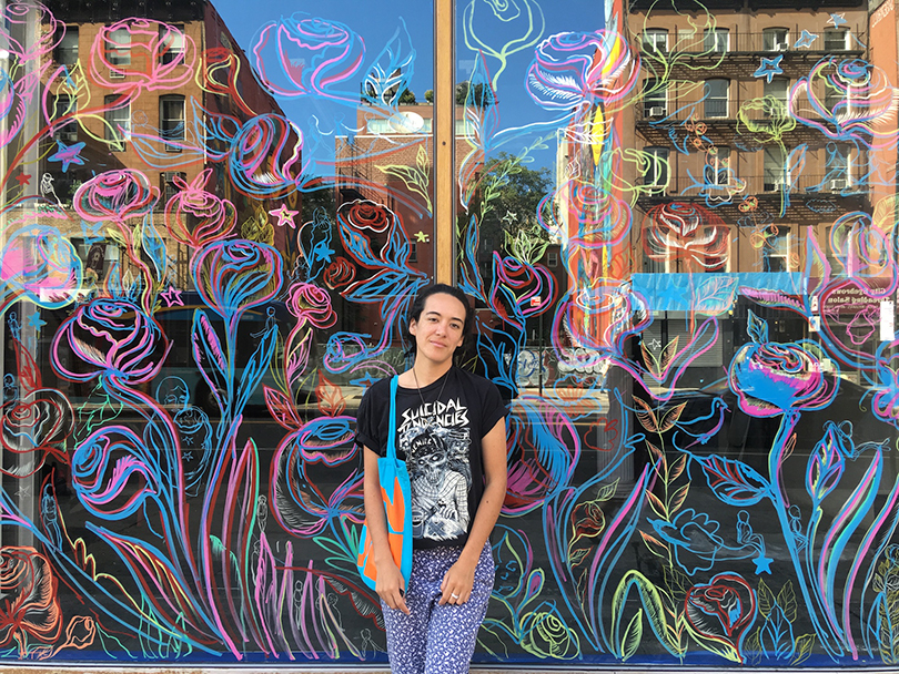 Maria de Los Angeles with her mural at the Pratt Manhattan campus