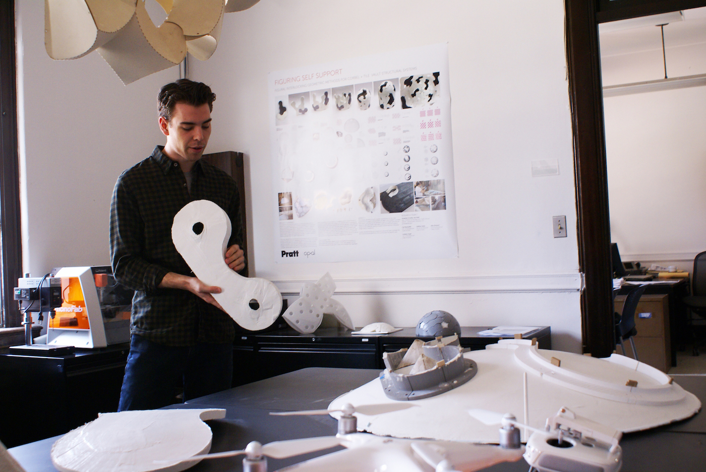 Cal MacAuliffe, BArch '21, presents Figuring Self Support, a project led by Jonathan Scelsa, assistant professor of Undergraduate Architecture, at the 2019 Research Open House (photo by Daniel Terna)