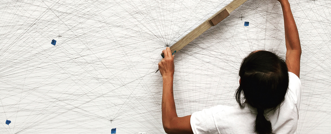 A student working on a Sol LeWitt drawing