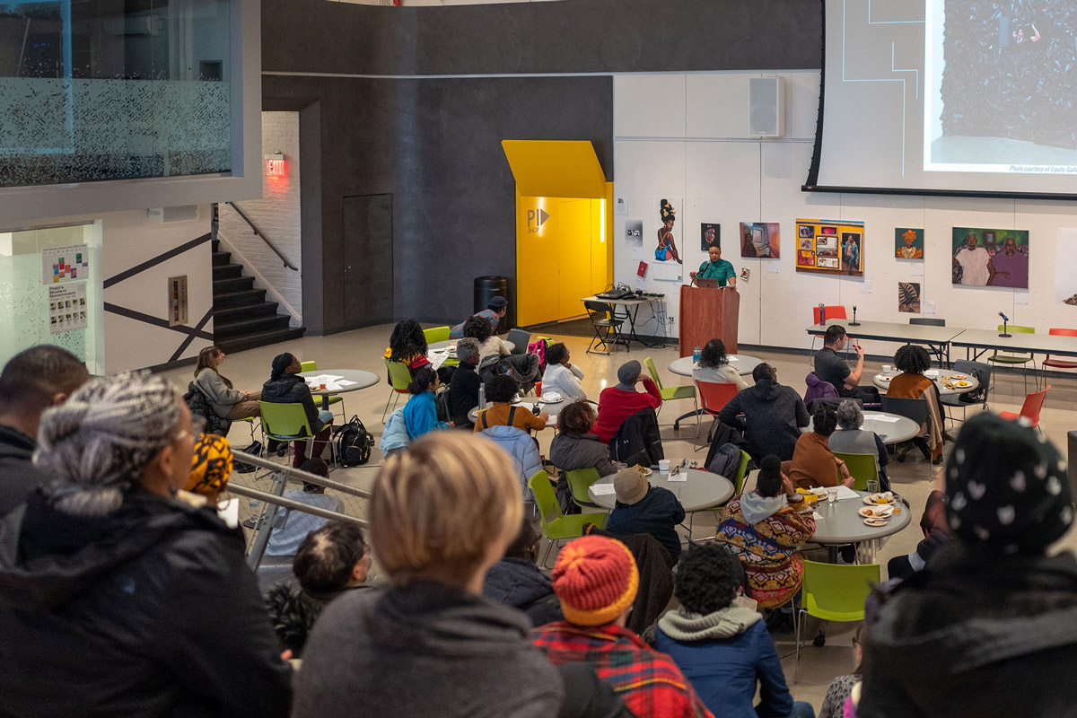 "Artist Taja Lindley speaking on ""Re-Membering is the Responsibility of the Living"" at the Teach-In (photo by Armon Burton)"