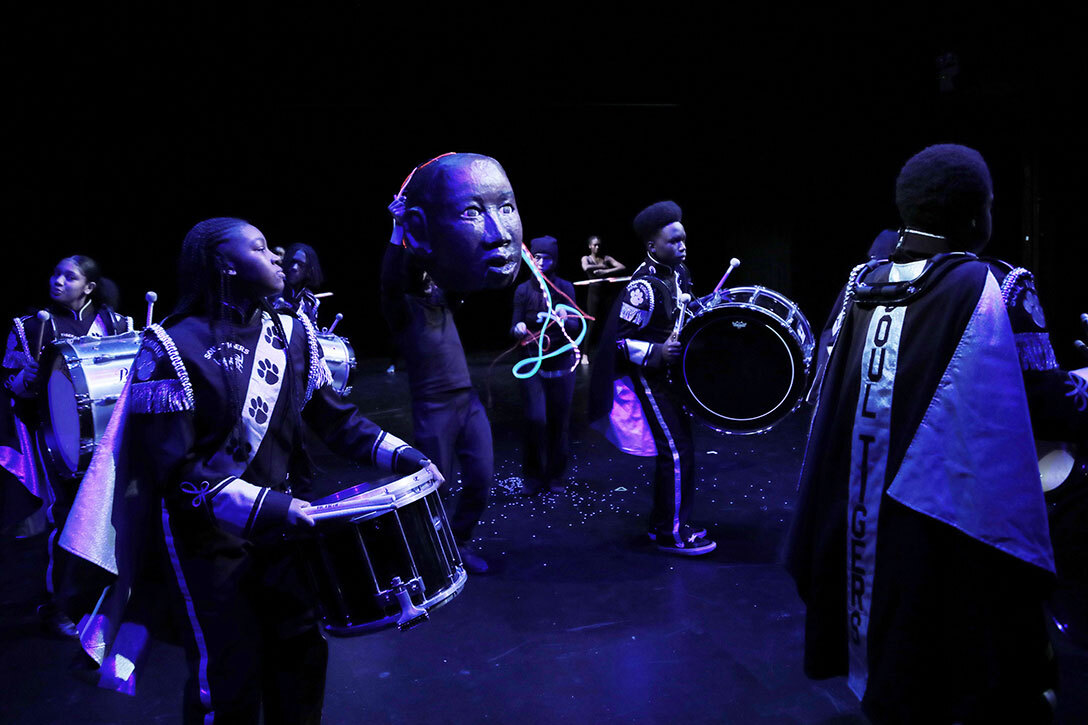 The Soul Tigers perform the finale number, flanking a puppet of Benjamin Banneker. Photo by Theo Cote