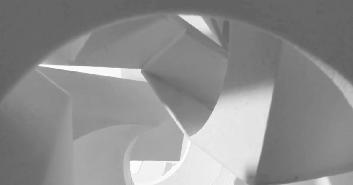 An abstract view of a structure with curved and fragmented surfaces