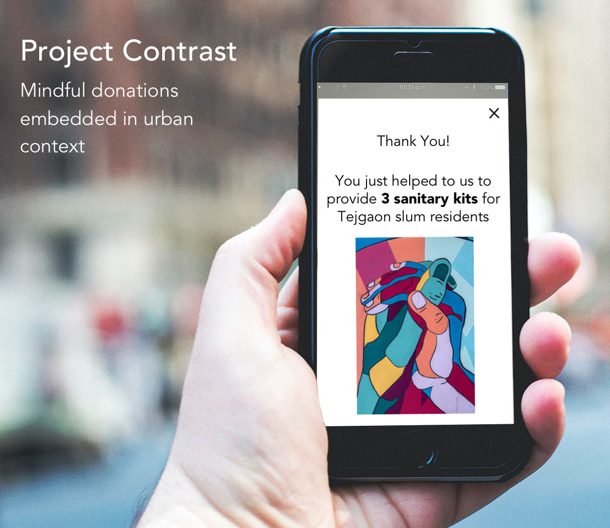 Hand holding mobile phone with status message about successful donation
