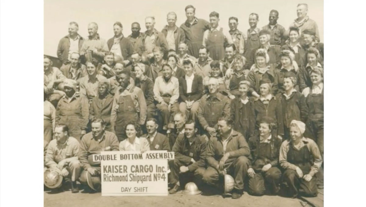 a group portrait of WWII factory workers