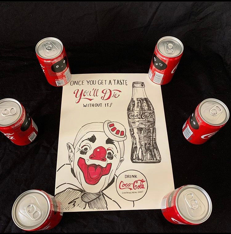 Sculpture of coca cola cans around centered drawing of clown