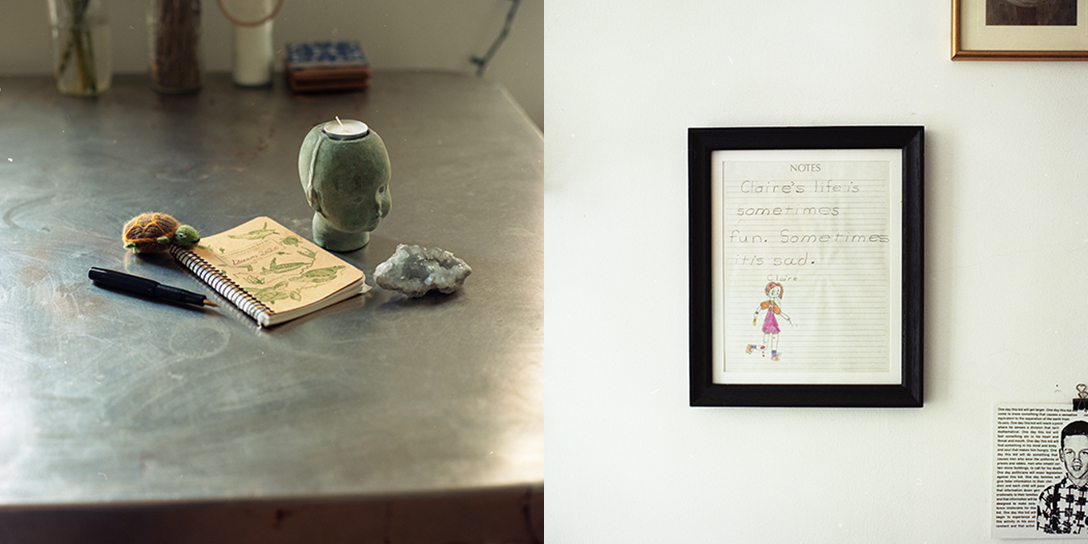Spiral notebook with by pen, stuffed turtle, votive candle in head-shaped holder, crystal; framed child's drawing of girl running