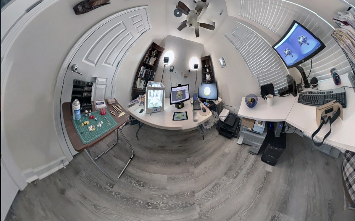Spherical view of digital architect Michele Gorman's studio, with 3-D printer, screens showing multiple views of a design object