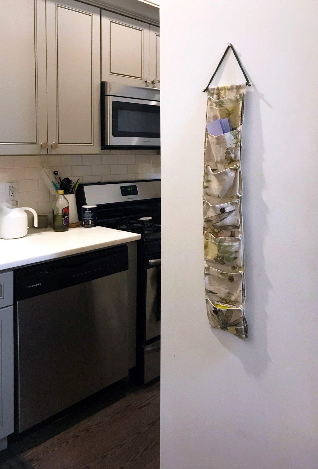 Fabricated activity kit by Pratt industrial design student Jae Wendell hanging on kitchen wall