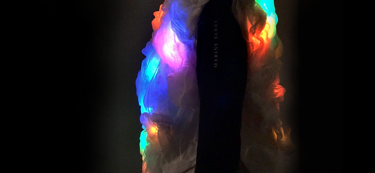 colorful lights on beneath the fabric swaths in the garment