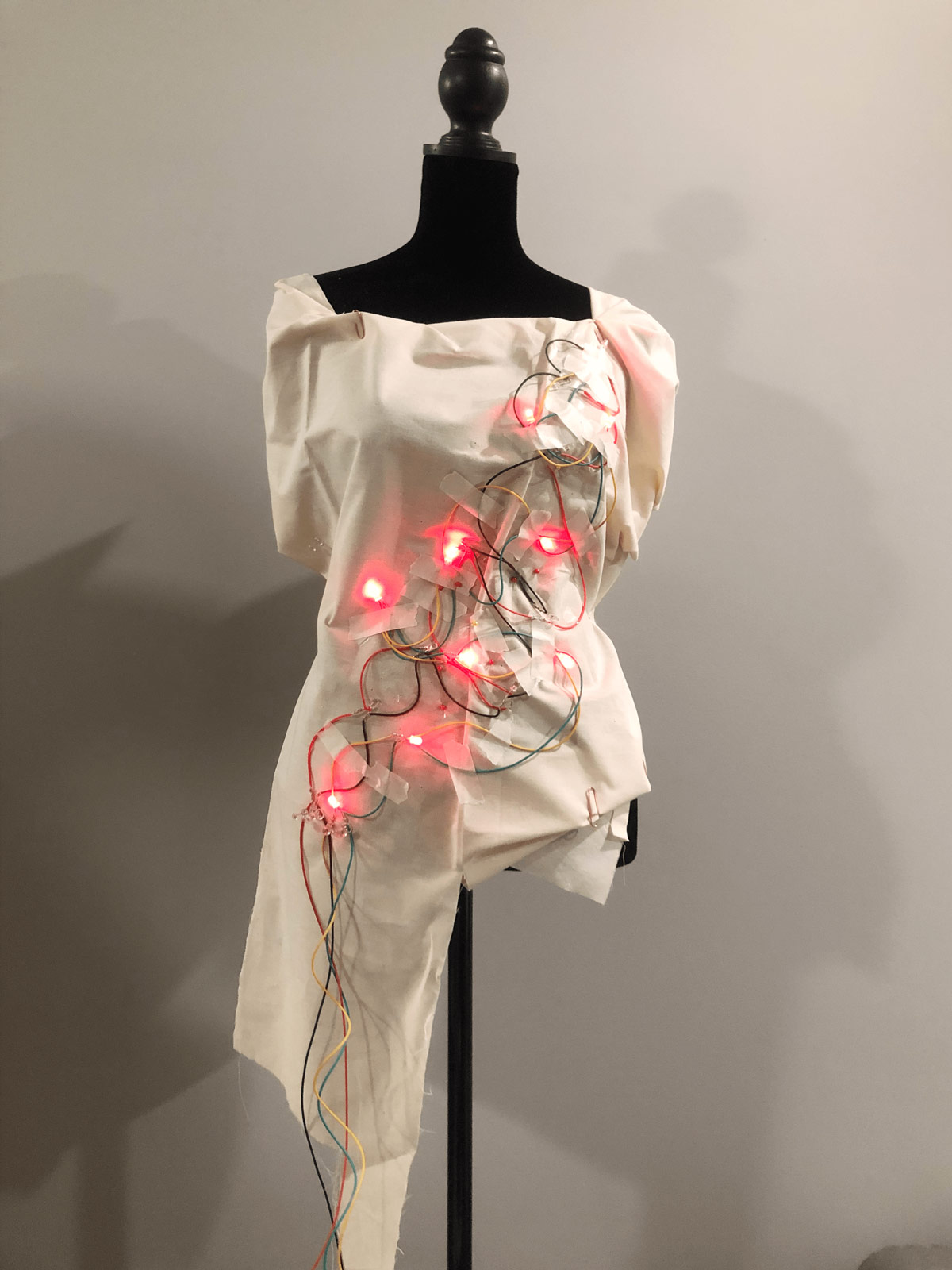 garment is lit up with red lights
