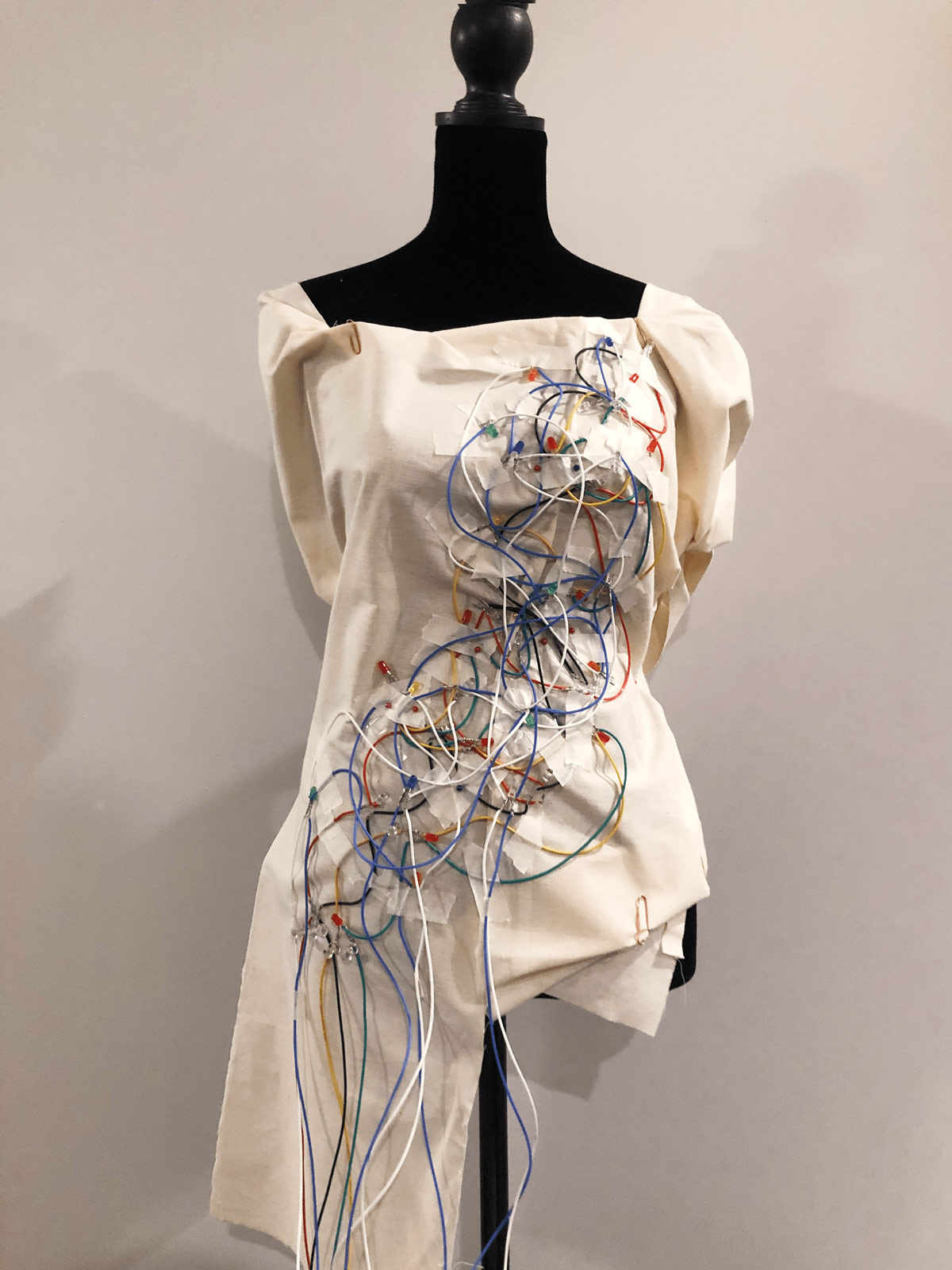 garment shows exposed wiring detail